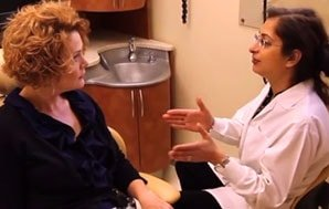 Dr. Kazerooni a McLean dentist explaining a procedure to a patient.