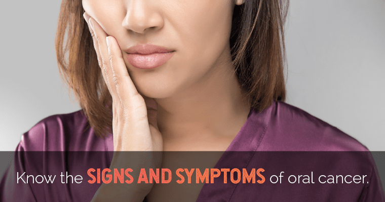 A woman holding the side of her jaw - Know the signs and symptoms of oral cancer