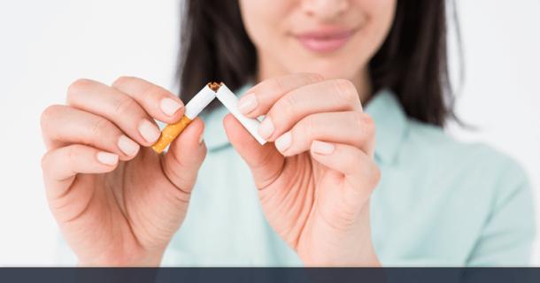 Woman breaking a cigarette in half.