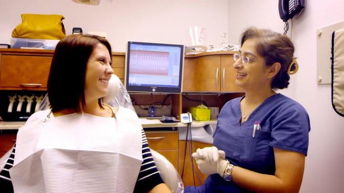 Dr Kazerooni talking with a patient